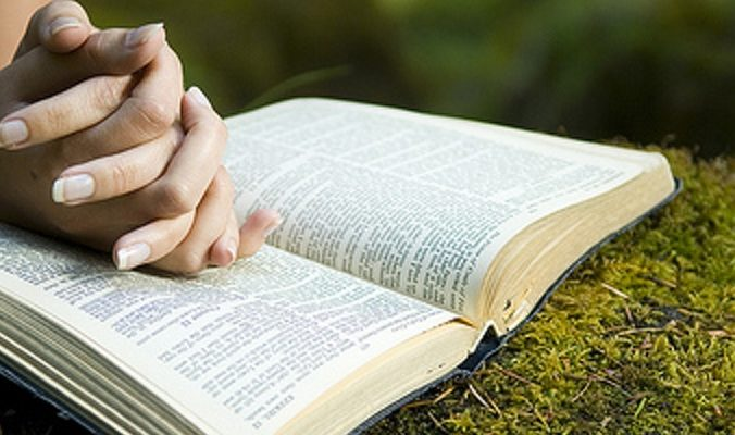 Healing Prayer - Young woman reading bible by stream in summer - Healing and Keeping Prayer